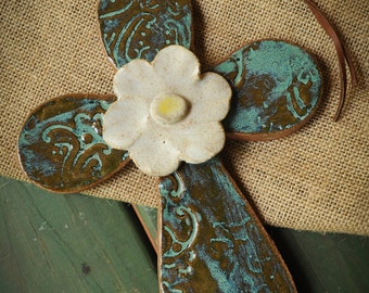 Pottery Cross with center flower and rawhide tie