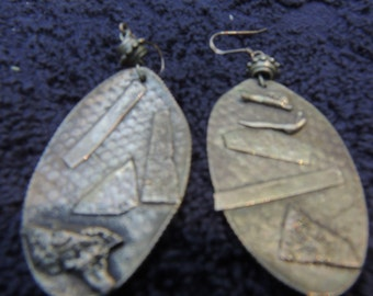 These silver coin earrings hang 2 1/2  inches long