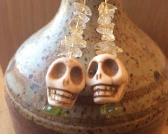 Skully earrings with precious stones