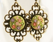 Delicate earrings in antique style with tiny flowers.