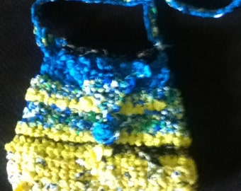 Hand crochet purses, clutches, and bags.