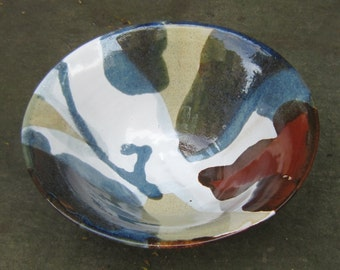 Bowl with blue, red and white glaze