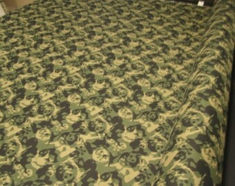 "New Skull And Cross Bone Skateboard 100 Percent Cotton Sheeting Fabric 60"" Wide By 36"" long. Sold by the yard."