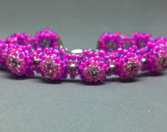Handmade pink and purple flower bracelet