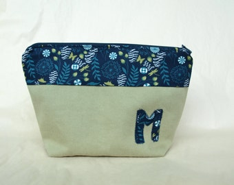 Toiletry bag, lined with pockets