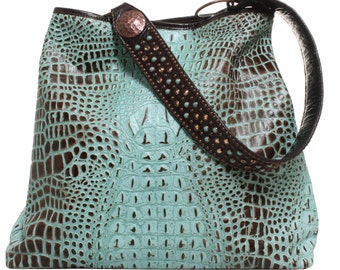 "All leather ""Big Tote"" made in our mint choclate chip alligator print. Chocolate colored leather strap with swarovski crystals and studs."