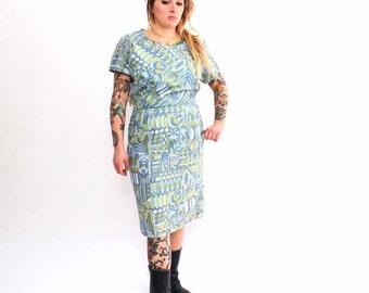 SALE 1960s dress . vintage wiggle dress in psychedelic kaleidoscope print . 60s sheath dress size  large - XL . geometric dress