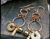 Crinoid fossil earrings, Artisan soldered rings Peridot Brass bell Clay bead Hammered copper chandelier