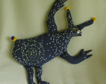 Petroglyph beast starry night plush