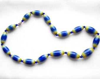 Graduated strand blue white yellow Seymour Chevron beads