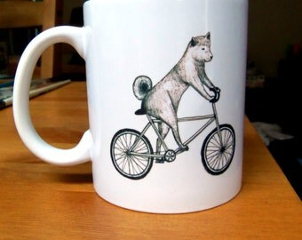 Shiba Inu Dog Riding a Bicycle Mug