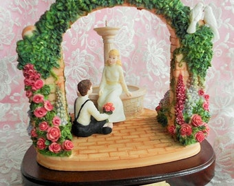 GLYNDA TURLEY FIGURINE Dated 1992 Courtyard Boy Girl Sweetheart Lover Fountain Pink Rose Garden Arch Lavender Floral Flower Artist Signature