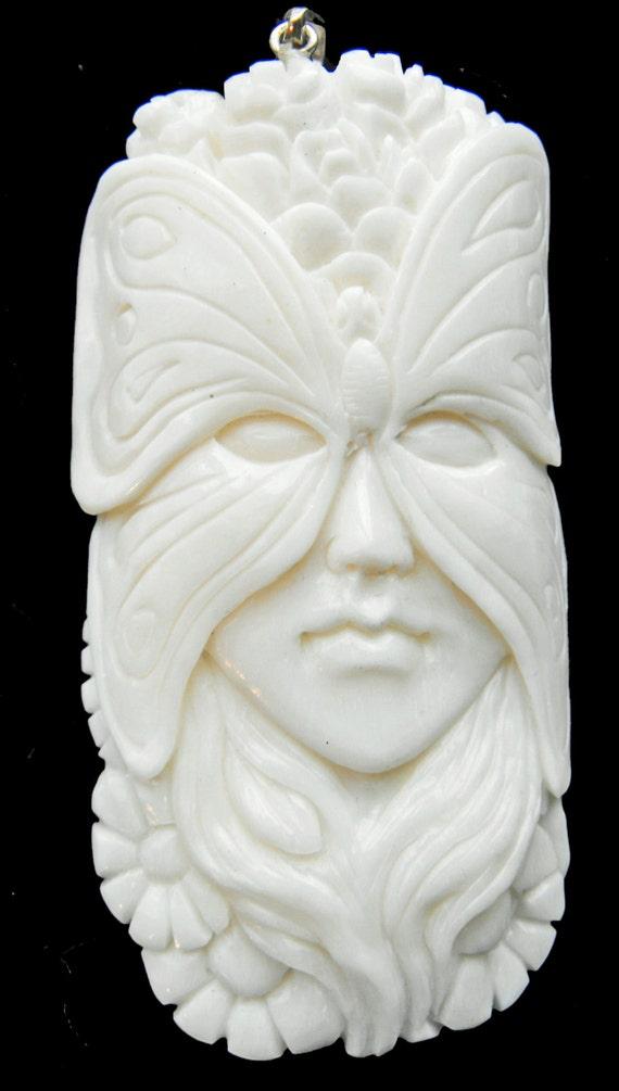 Hand carved bone pendant butterfly fairy goddess mask spirit