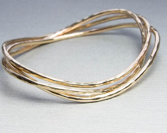 Fluide: Wavy Hammered Gold Bangle Bracelets, Set of Three Stacking Bracelets. Custom Jewelry. Gift For Her. Gold Filled Jewelry