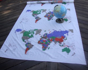 Continuously 3 pieces of The World map fabric is cover the world and continent is one of several very large landmasses on Earth