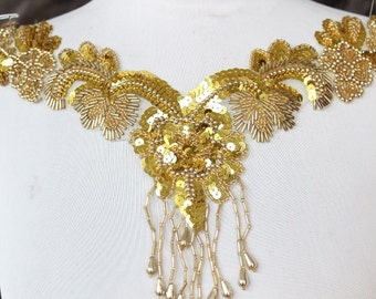 Cute  beaded and   embroidered  applique with  sequence  gold color   1 pieces listing 13 1/2 inches wide at the neck