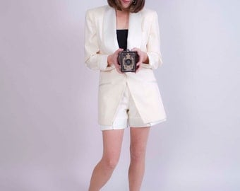vintage Nicole Miller ivory women's wool suit . tailored suit jacket and high waisted shorts . designer vintage