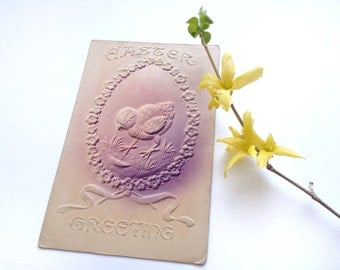 Antique Easter postcard, deeply embossed, spring chick, egg, flower wreath, ribbon, tan and purple pink, Edwardian vintage 1910s, airbrushed