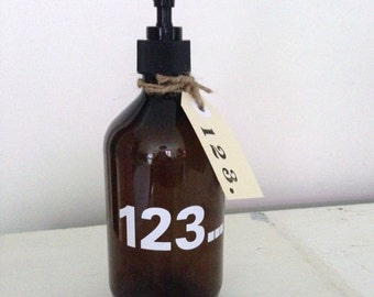 Fabulous ECO FRIENDLY upcycled amber pump dispenser bottle for the bathroom or kitchen.Great typographics