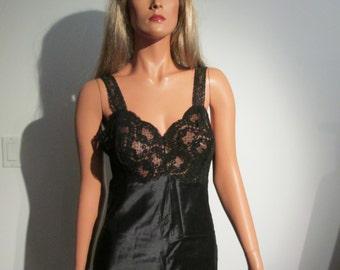 Vintage 1960's Black full slip. All Nylon.  Bali, size 34 short  New old stock.