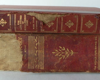 vintage book decor tattered leather spines Dictionary and Huckleberry Finn from Diz Has Neat Stuff