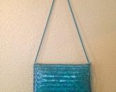 deep turquoise woven straw chevron purse