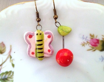 Butterfly and Cherry Mismatched Earrings. Whimsical. Red. Fruit. Pink. Glazed Ceramic. Antique Gold Ear Hooks. Dangle Earrings. Under 15.