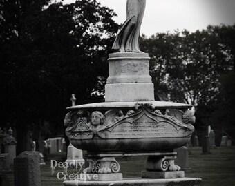cemetery headstone monument statue photo