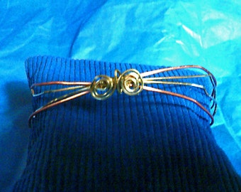 Handcrafted gold and tangerine wire cuff