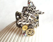 Steampunk watch parts adorned with butterfly and watch cogs.