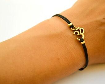 OM bracelet, black bracelet with gold tone Om charm, Hindu symbol, black cord, gift for her, yoga bracelet, lucky charm, minimalist, zen