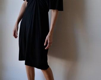 Black jersey dress with kimono sleeves, midi length. Gatsby. One size fits many.