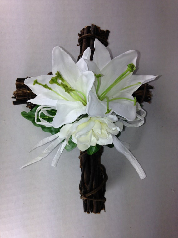 Easter cross natural grapevine twig cross with white easter lillies white gardenia bright green leaves and white raffia bow