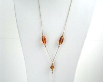 Collier sautoir bohême romantique brun cognac et doré en verre et cristal