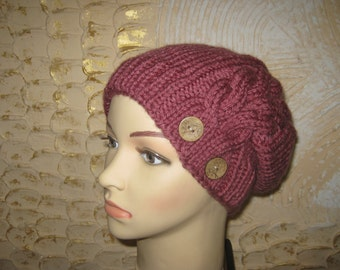 Knitted hat for women. Hat with buttons