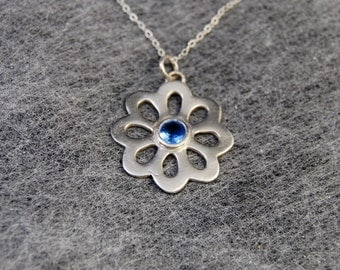 Silver flower necklace with faceted blue spinel lab gemstone