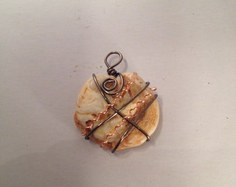 Wire wrapped shell necklace.