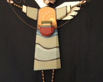 "Wooden Angel, Title ""Here comes the Sun"""
