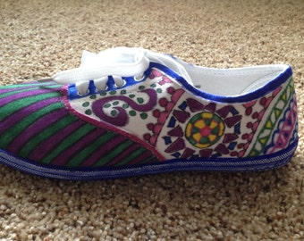 White canvas shoes with Sharpie artwork