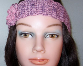 Headband, Woman's crochet accessory for her hair. The headband is embellished with pink crochet flower.