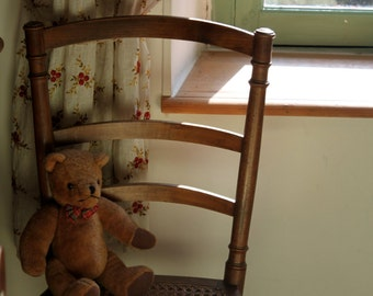 Morning sunlight on a chair with a teddy bear