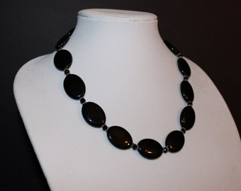 Necklace - Elegantly Simple Swarovski Black Rondelles Surround Stunning Black Onyx Beads with Antique Silver Daisy Wheel Spacers