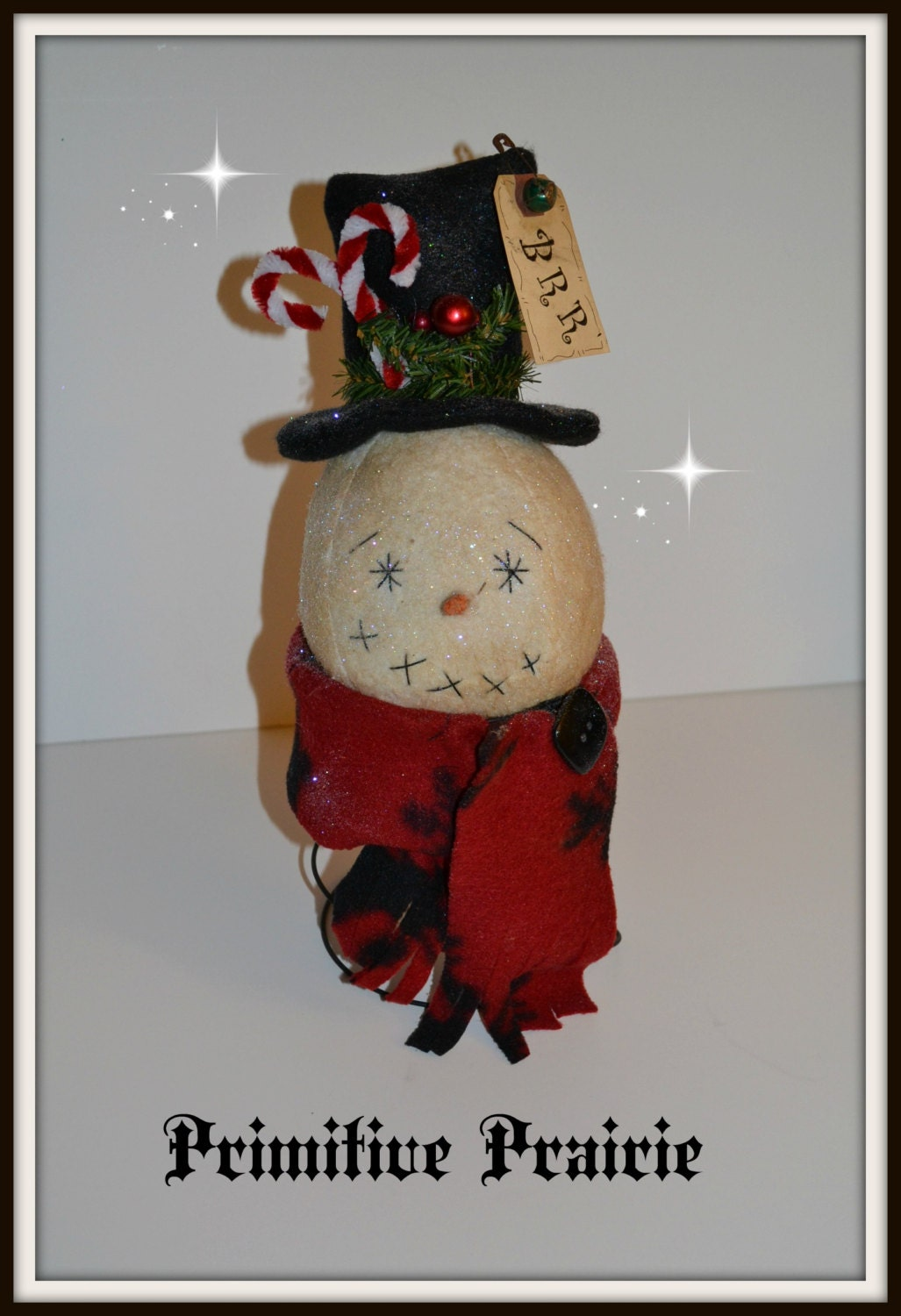 Primitive winter snowman on a handmade bed spring, handmade winter snowman decoration Christmas decoration