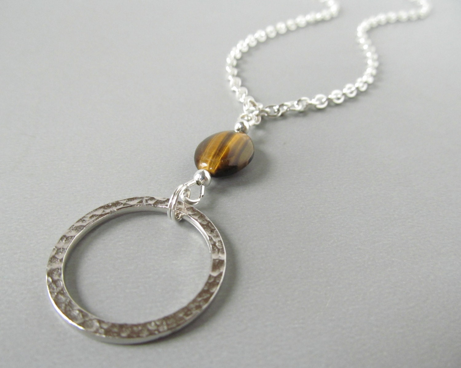 silver eyeglass necklace with brown tiger eye beaded lanyard