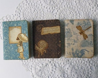 Set of three small scrapbook notebooks, sketch pads, travel journals, with cottage chic blue, beige and black patterned papers.