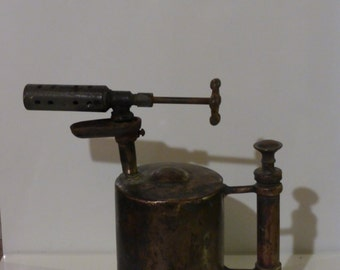 Otto Bernz Co. Newark, Nj. Patent 1909 antique blow torch. This is a brass gas kerosene torch. Leave as is or polish up to a bright sheen.
