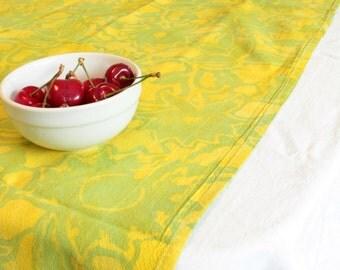 green and gold batik towel