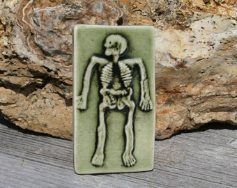 Spooky skeleton halloween decoration - handmade ceramic tile - green - boney decoration