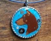 Doberman Pinscher Steampunk pendant in Polymer Clay by darbella