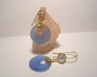 Blue sea glass round dangles on crystal embellished hand made ear wires.
